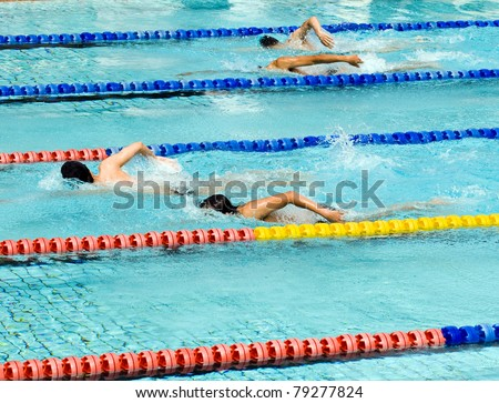 people  swimming during a competition