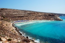 People swimming in the blue sea of Lampedusa, Italy. Summer 2009