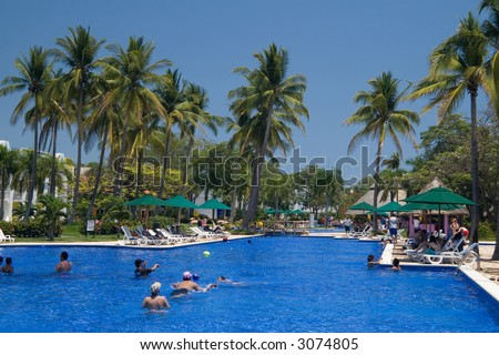 People swimming inthe gorgeous pool at a tropical resort in El Salvador