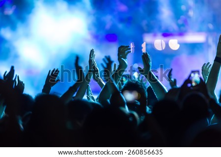 People taking  during a music entertainment public concert