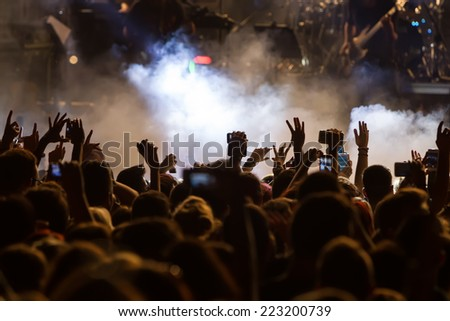 People taking photographs with touch smart phone during a music entertainment public concert #223200739