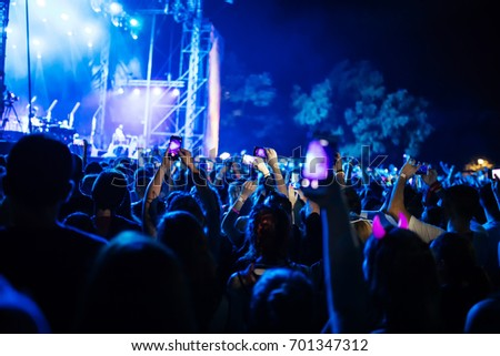 People Taking Photos At A Music Concert With Smartphones #701347312