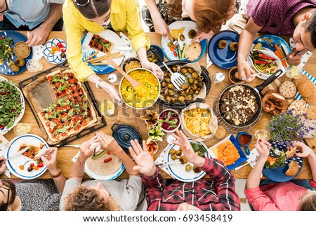 People talk and eat together during meeting at table with bio and organic food - Shutterstock ID 693458419