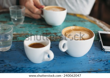 People talking in the cafe while having some fresh coffee
