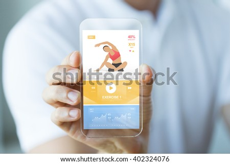 people, technology, sport and fitness concept - close up of male hand with smartphone with sports application on screen #402324076