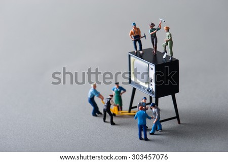 People to repair the cathode-ray tube TV Stock Photo