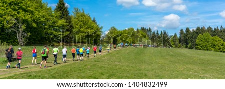 People trailrunning in beautiful mountain landscape panorama