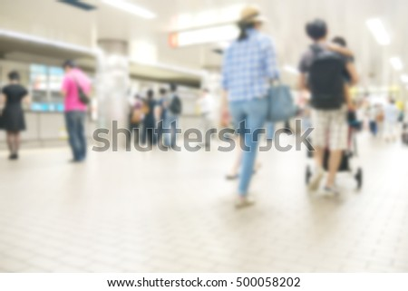 People traveling at train station in blurred motion with retro color effected, Abstract blur people background #500058202