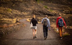 People trekking at Mount Etna, Sicily, Italy.