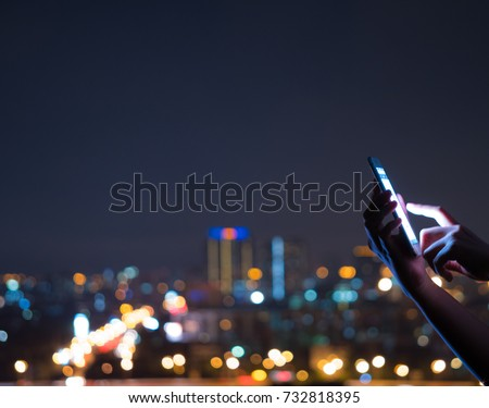 people using smart phone cell app technology background lifestyle hand holding mobile contact for business and digital text communication city light at night with dark blue bokeh #732818395