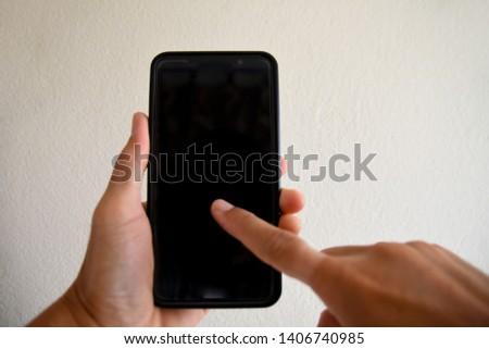 People using smartphones using hands