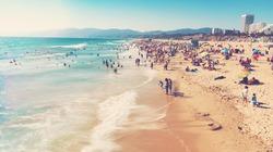 People visit the beach in Santa Monica, California
