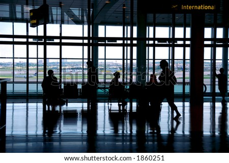 People waiting at the airport terminal