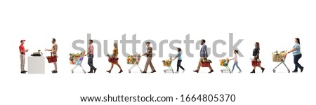 People waiting at the cash register in a supermarket and a guy cashier worker standing at the till isolated on white background
