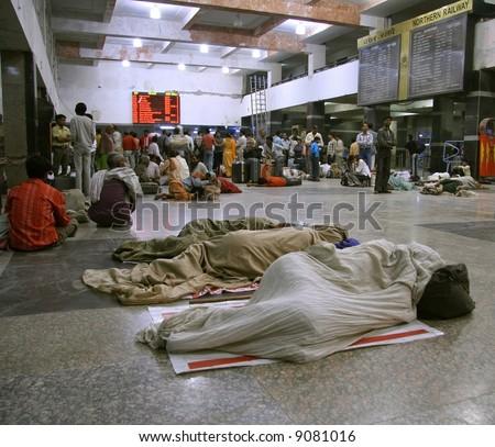 people waiting at train station, delhi, india