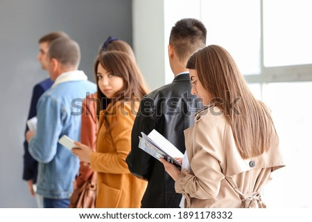 People waiting in line at the airport Сток-фото ©