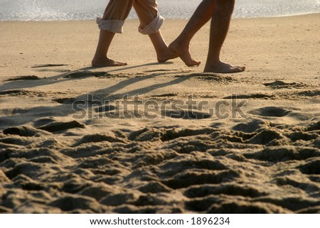 people walk on the beach barefooted