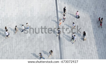 people walk on the pedestrian city street walkway on pavement concrete with the teenage young boy and girl and the group of fashion man and woman. (Aerial urban city photo)