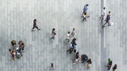 people walk on the pedestrian street walkway with the teenage young man and the group of family with little child. (Aerial urban city photo)