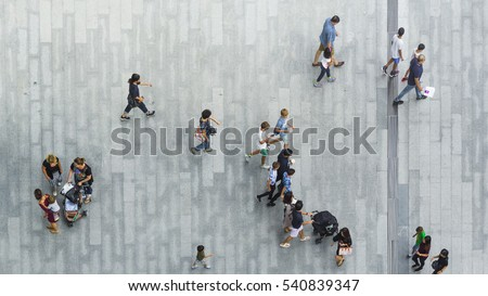people walk on the pedestrian street walkway with the teenage young man and the group of family with little child. (Aerial urban city photo) #540839347