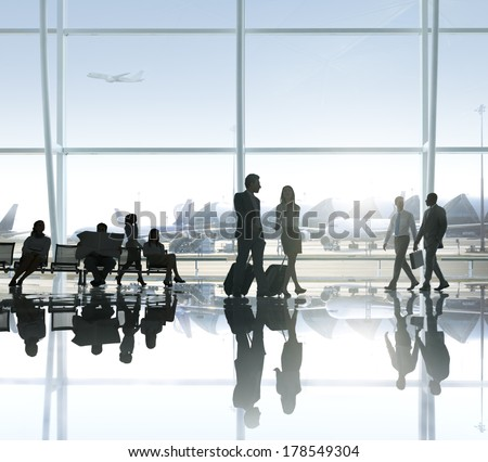 People Walking and Waiting in an Airport stock photo