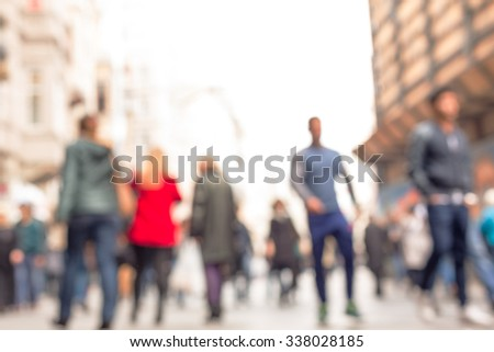 People walking down the street namely '' Istiklal  '' which is one of the main shopping area in Istanbul.The photo is purposely shot and made out of focus Foto stock ©
