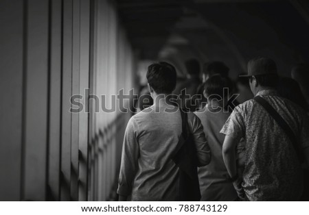 people walking in city street. people walking on street of business city,Bangkok,Thailand,black and white tone. #788743129