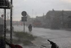 People walking in heavy rain in Vietnam