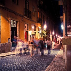 People walking in Lisbon at night