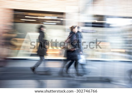 People walking in shopping centre,  zoom effect, motion blur #302746766
