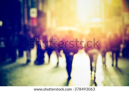Shutterstock people walking in the street, blurry