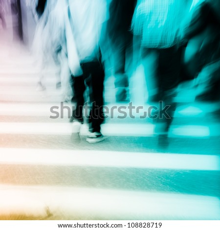 people walking on big city street, blurred motion zebra crossing abstract