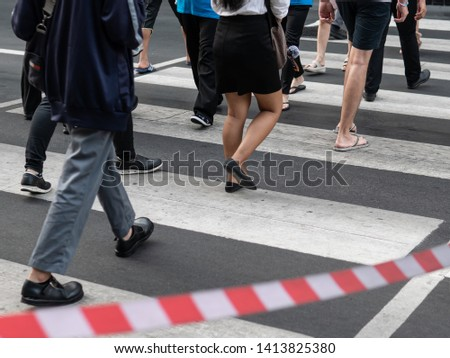 people walking on pedestrian walking