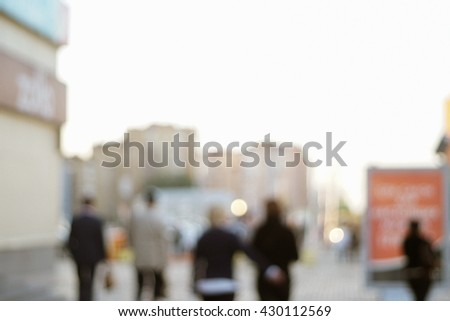 People walking on street in the evening  Intentionally blurred and