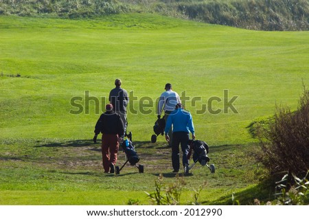 people walking on the golf course