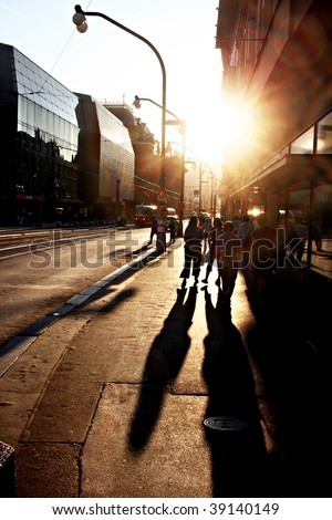 People walking on the street of Prague at sunset