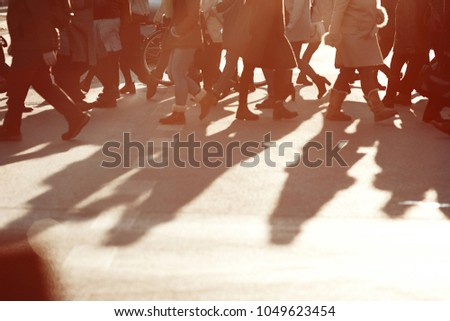 People walking on the street with sunset background #1049623454