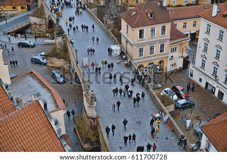 People walking over Charles Bridge - aerial view - PRAGUE / CZECH REPUBLIC - MARCH 19, 2017 #611700728