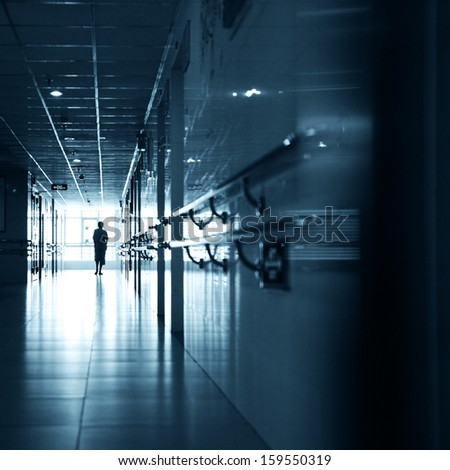 People walking through the hospital corridor.