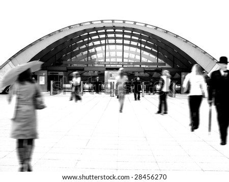 People walking to the underground station, London (high key motion blur black and white)