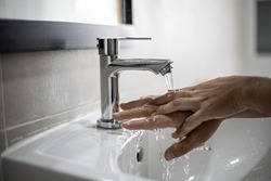 People washing their hands in the sink, washing their hands thoroughly is a precautionary measure against COVID-19 infection. Everyone washes their hands regularly in the right way.