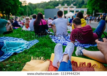 people watching movie in open air cinema in city park #1119944234