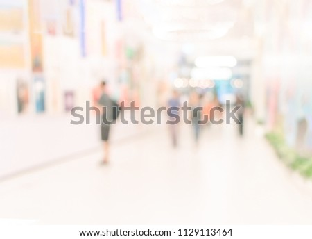 People Watching Photograph or Image in Art Gallery Museum, Abstract Blur or Defocus Background. Blur or Defocus image of the lobby of a modern art center as background with bokeh. #1129113464