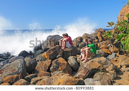 People watching the waves crash on the North Coast of the Big Island of Hawaii