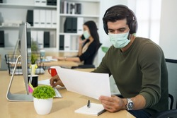 people wearing face mask and work at office
