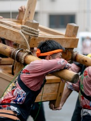 People who are lifting a portable shrine at a Japanese traditional festival, Japan