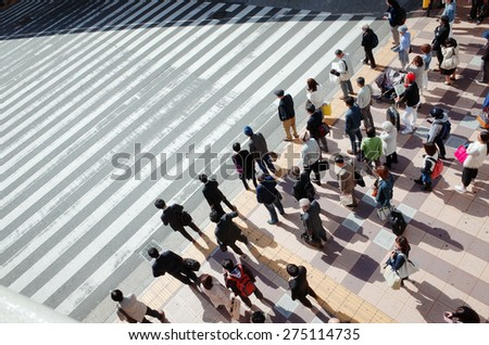 People who walk the crosswalk to dusk