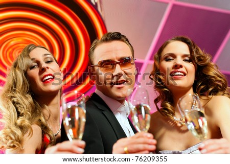 People with champagne in a bar or casino having lots of fun