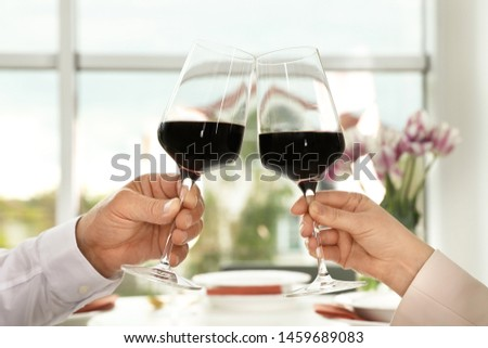 People with glasses of wine on blurred background, closeup #1459689083