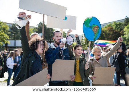 People with placards and amplifier on global strike for climate change.